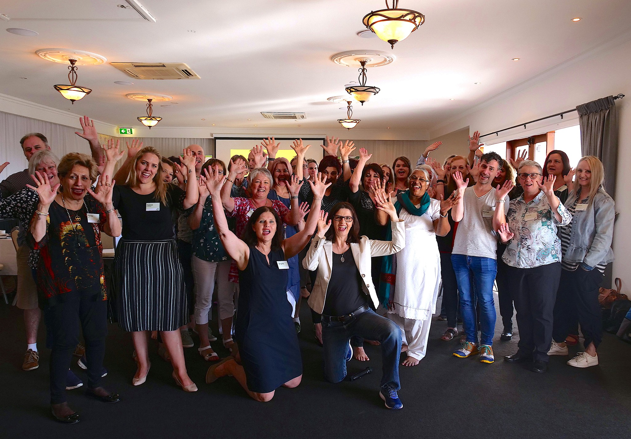 Bowen Training Australia instructors and staff group photo hands in the air